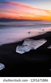 ICElandic the lonley icecube at the black beach during sunset