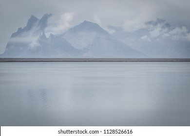 Icelandic Mountain Range with snow capped mountains - Iceland - Very peaceful scene