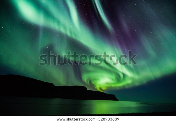 Icelandic spiral northern lights in autumn time