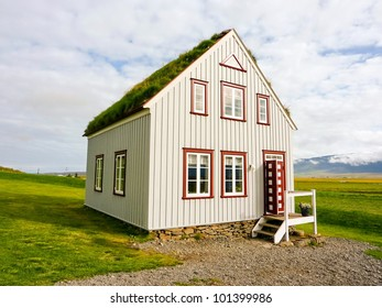 Icelandic traditional alone turf roof house in countryside