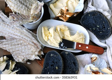 Icelandic typical dried fish (Hardfiskur) with charcoal bread and butter.