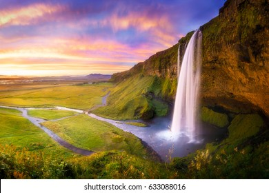 Icelandic waterfall Seljalandsfoss at sunset
