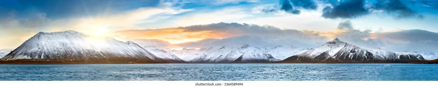 Icelandic winter panorama in Vesturland region with Lambahnukur, Gunnulfsfell, Snjogilskula, Kolgrafamuli mountain peaks behing Kolgrafafjordur fjord