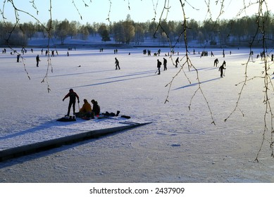 Ice-skaters at the lake Bogstadvannet in Oslo in Norway