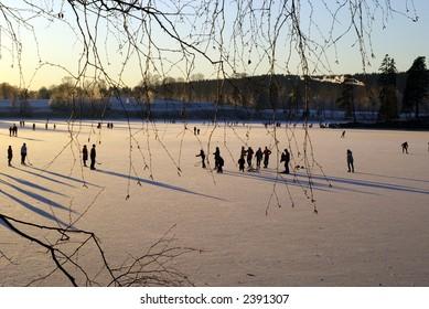 Ice-skaters on the lake Bogstadvannet in Oslo