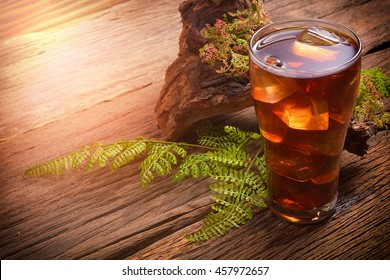 icetea and green leaf on rustic wooden table