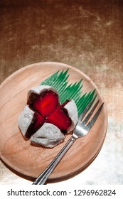 Ichigo Daifuku, strawberry mochi Japanese confection made from a strawberry, rice cake and red bean. Top view shot