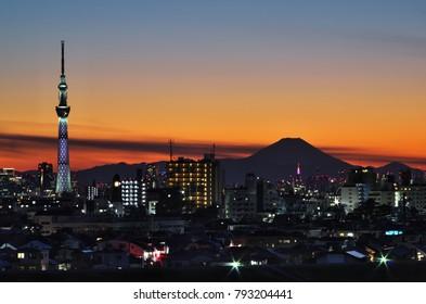 Ichikawa City, Chiba Prefecture, Japan, January 14 2018: Beautiful Tokyo night view cityscape , Tokyo Skytree landmark and Mountain Fuji in winter sunset.