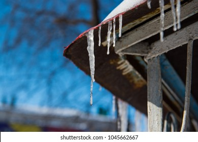 Icicle hangs from the roof