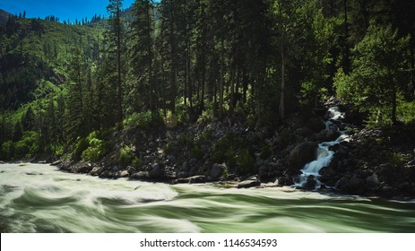 Icicle River during spring runoff near overflow levels in North Central Washington