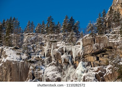 Icicle rock formation canyon trees sunny