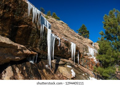 Icicle Stalactites Hanging from Rocks in the Mountains