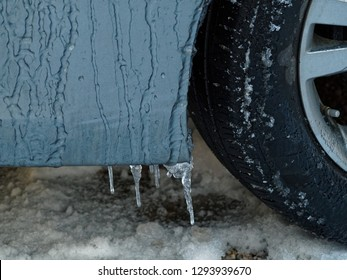 Icicles forming on the door to a car on a freezing winter morning.