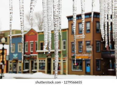 Icicles hanging in front of Crested Butte, Colorado, a small colorful ski town