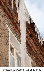 Icicles hanging from  house.Large icicles hanging from the roof.
