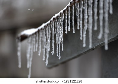 icicles hanging from a metal roof