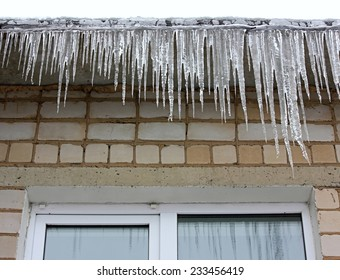 Icicles hanging on the eaves of the roof
