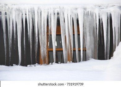 Icicles hanging over the roof in a severe winter