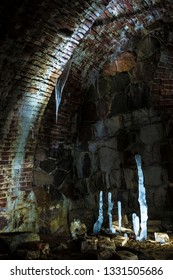 Icicles and ice stalagmites in the darkness of casemates of Daugavpils Fortress. Daugavpils Latvia.