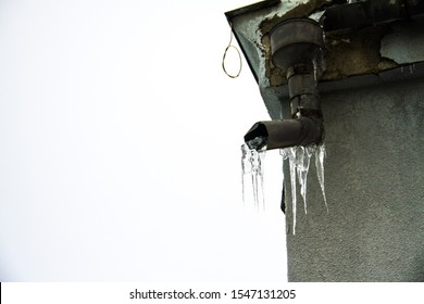 Icicles. Ice. Waterspout. Rainwater pipe