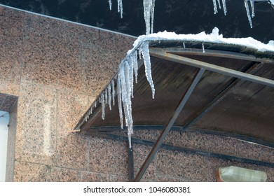 icicles on the peak of the building
