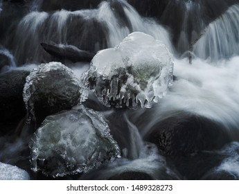 Icicles on rock in streaming water with long exposure