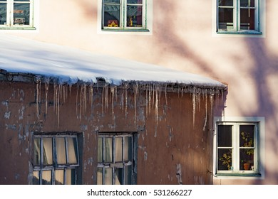 Icicles on the roof of the house warm. Tallinn, Eatonia