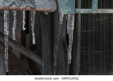 Icicles on an vintage truck.  Cold and icy.  Macro.