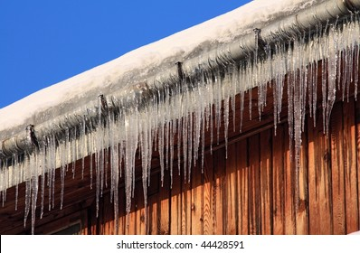 icicles on wooden house