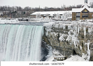 Icicles run in falls down the escarpment beside the rushing water of the Canadian Niagara Falls just above the entry to the Journey behind the Falls.