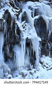 icicles and snow on rocks