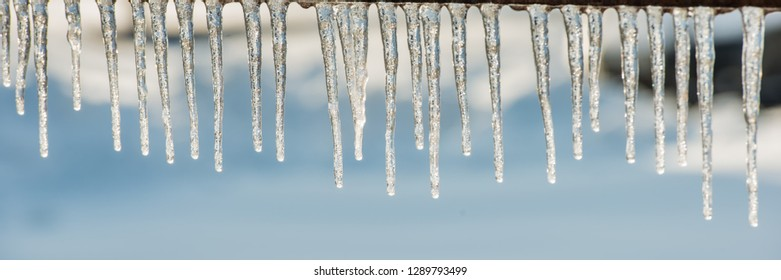 icicles in sunny weather, panoramic. Winter season. Web banner for design. Ukraine. Europe.