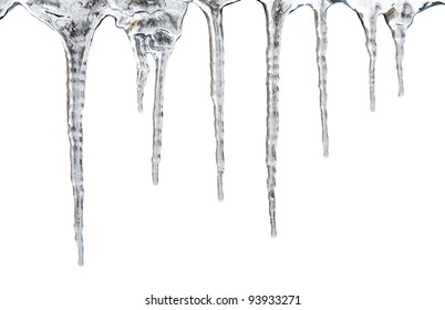 icicles which are hanging down from a roof. Isolated on white with clipping path