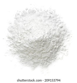 Icing, caster, confectioners or powdered sugar pile from top view isolated on white background