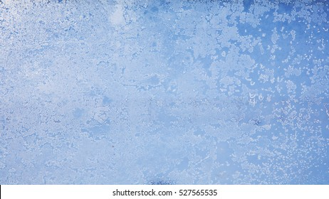 The icing on the Windows, frost on blue sky background