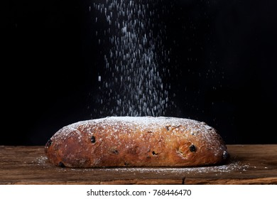 icing sugar falling on a dresdner stollen