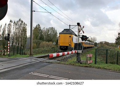 ICM intercity of NS named Koploper at a railroad crossing in Alphen aan den Rijn at single track