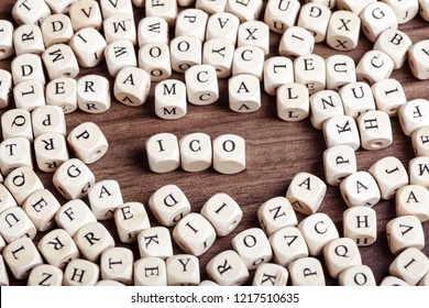 ICO abbreviation word in letters on cube dices on table.