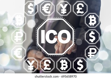 ICO - Initial Coin Offering Bitcoin Digital Electronic Binary Money Financial concept. Man presses currencies cloud button on a virtual graphical user interface.