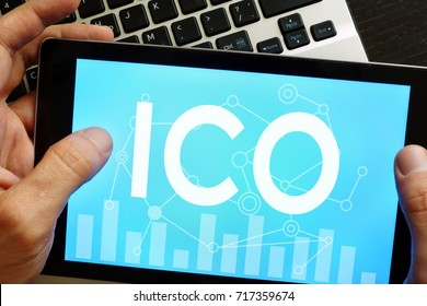ICO Initial Coin Offering on a screen of tablet.