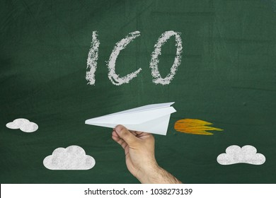 ICO - The initial concept of coin placement for the funding startup projects. Paper airplane and ICO text on chalkboard