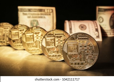 ICO for startup funding - concept. Initial Coin Offering is an alternative to an IPO for launching a cash flow. In the picture there are coins of electronic currency and cash dollars.