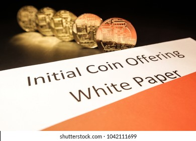 ICO White Paper in an envelope. Concept Initial coin offering. In the picture documents for the issue of electronic currency and gold coins.