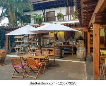Icod de los Vinos, Spain; December 2, 2018: Image of the millenary drago of Tenerife. View from cafeteria and relax area in the Casa del Drago.