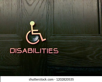 Icon of disabled person in front of toilet room
