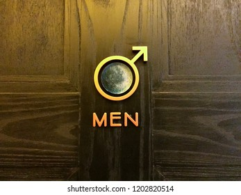 Icon of men in front of toilet room
