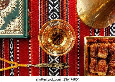 Iconic Abrian fabric is graced with sybbols of Arabia, in particular Arabic tea and dates, they symbolise Arabian hospitality.