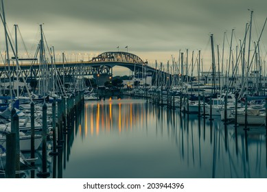 The iconic Auckland Harbour Bridge reflecting on Westhaven Marina