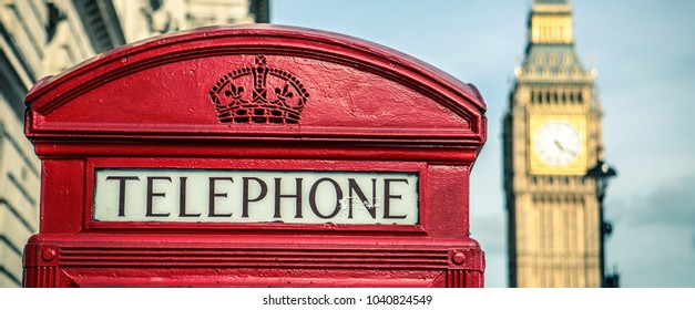 iconic british old red telephone box with the Big Ben at background in the center of London