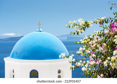 Iconic church with blue cupola in Oia, Santorini, Cyclades, Greece